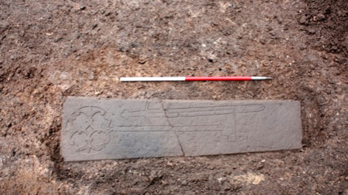 "'Medieval knight' unearthed in Edinburgh car park dig The remains of a medieval knight or nobleman found underneath a car park are to be moved to make way for a university building. The grave and evidence of a 13th Century monastery were uncovered when archaeologists were called to an Edinburgh Old Town building site. An elaborate sandstone slab, with carvings of a Calvary Cross and ornate sword, marked the grave. The car park was cleared to build a new Edinburgh Centre for Carbon Innovation. As part of low carbon measures for the University of Edinburgh scheme, work was being carried out in the former car park to create a rainwater harvesting tank for the new building. It was already known the area had been the site of the 18th Century Old High School, the 16th Century Royal High School and the 13th Century Blackfriars Monastery. Along with the knight or nobleman's grave and skeleton, the excavation has revealed the exact location of the monastery, which was founded in 1230 by Alexander II (King of Scotland 1214-49) and destroyed during the Protestant Reformation in 1558. Richard Lewis, the City of Edinburgh council culture convener, said it was hoped more would be found out about the remains, but the grave had already been dated to the 13th Century. ""This find has the potential to be one of the most significant and exciting archaeological discoveries in the city for many years, providing us with yet more clues as to what life was like in Medieval Edinburgh,"" he added. The project's archaeological services have been provided by Edinburgh-based Headland Archaeology. The archaeologist who found the grave, Ross Murray, had studied at the University of Edinburgh on a site only yards from where the find was made. Mr Murray said: ""We obviously knew the history of the High School Yards site while we were studying here but I never imagined I would be back here to make such an incredible discovery."""