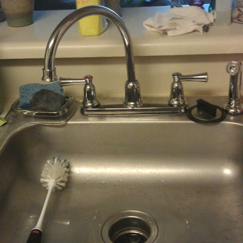 Came home to a brand new kitchen faucet…with a sprayer! I'm washing e'rybody's dishes!