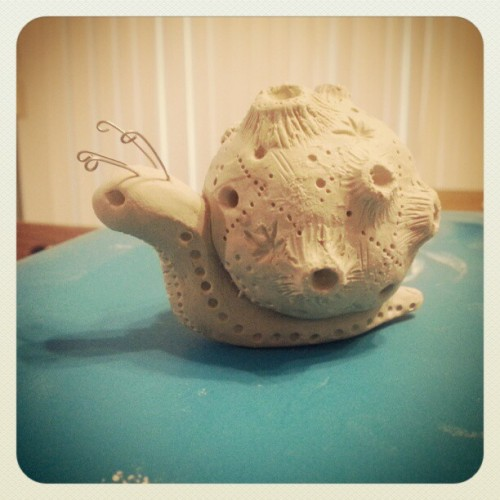 dragonstarart:  Little asteroid snail is drying. This one is getting a very special glaze treatment. :)