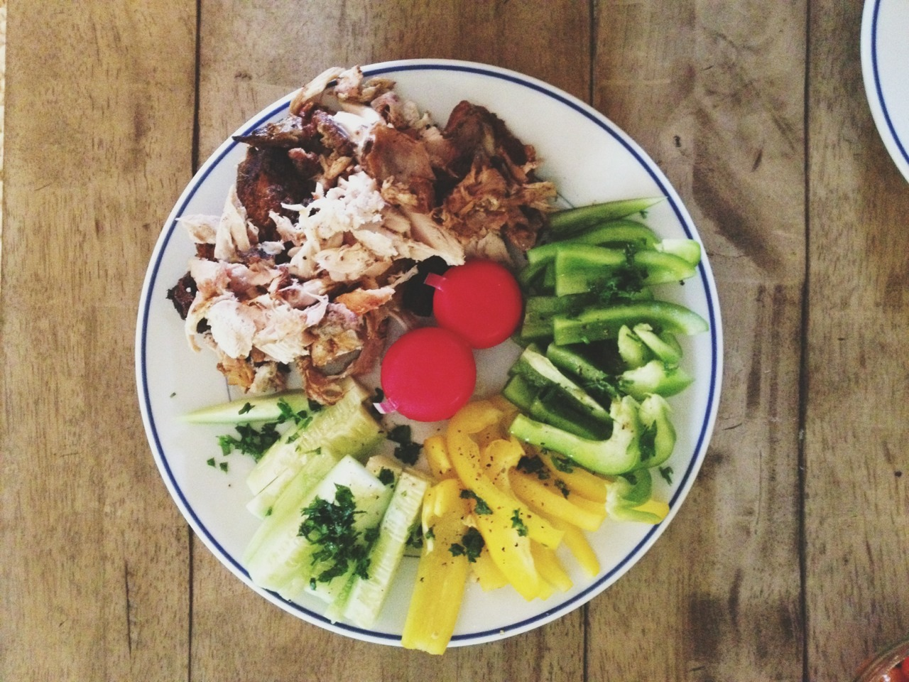 snack plate  chicken (rotisserie) chopped bell pepper cucumber parsley cheese  olive oil, salt, pepper not pictured: grape tomatoes, pickles, chips