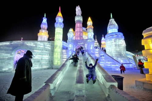Hot colors light up frozen sculptures at the Harbin ice festival (Photo: Diego Azubel / EPA) People slide down an ice slide at the 29th Harbin International Ice and Snow Festival in Harbin, China, on Jan. 6. The annual festival features hundreds of activities related to snow and ice. Picture made available Jan. 7. See more photos.