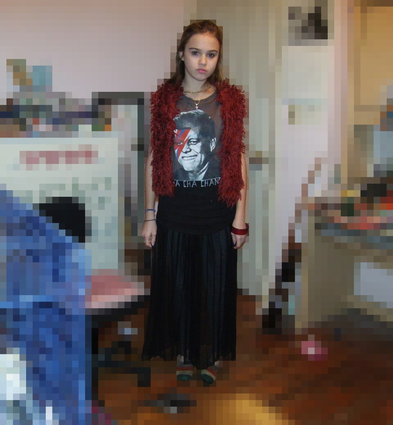 "I pixelated the background to spare your eyes from the pigsty that is my room. My sister got me this awesome shirt that has JFK with the Ziggy Stardust lightning bolt and ""CHA CHA CHANGES"" underneath. I think it's pretty perfect but my freshman year history teacher was the only person who seemed to ""get"" it. Those are actually pants, not a skirt, that I got at a thrift store. They're transparent so I have to wear thick leggings underneath them. Thrifted shoes and F21 vest."