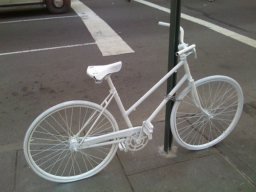 view-from-up-here:  caluhfornia:  Ghost bikes are white painted bikes used as roadside memorials for cyclists who have been killed or injured.  woah