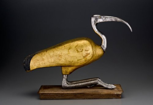 sporadicq:   Ibis Coffin, Egypt, 305-30 B.C. Wood, silver, gold, and rock crystal, 15 1/16 x 7 15/16 x 21 15/16 in. (38.2 x 20.2 x 55.8 cm). Brooklyn Museum (Gavin Ashworth, photographer), 2012. In Ancient Egypt animal mummies were routinely placed in some type of container once the animal had been wrapped in linen. At times elaborate coffins were crafted to hold the animal mummies. Just as human coffins were anthropoid, some animal coffins took the form of the animal contained. The ibis mummy held by this coffin was placed within through the detachable lid on the back. The gilding of the body and the exquisite detailing of the head, legs, and feet make this example one of the finest of its kind. (Source)