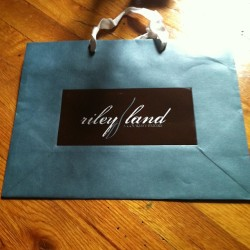 5/15 Gifts from the gods…  First edition Riley Land shopping bag! (at Home of The Muse)