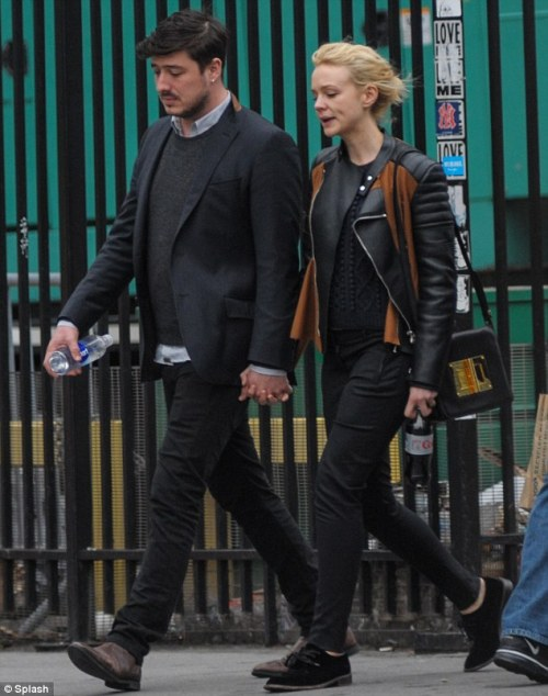 americann0mad:  elizabethswardrobe:  Marcus Mumford and Carey Mulligan with a Tom Ford bag in New York.  ^That  makes it sound like the Tom ford bag is like their baby hahaha