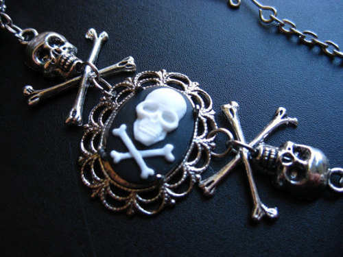 "LAST ONE!!! ""Even Death May Die"" has a small skull cameo in pewter setting, four tibetan silver very detailed skulls and crossbones and black onyx beads.  Find it on our Etsy Store.  https://kiglobal.etsy.com/"