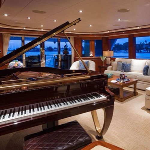 A Sol Vas piano design on a client's yacht. Finished in gold and Sapele mahogany. #resinno #madeintheUSA #piano #craftsman #wood #pianodesigner #leather #art #dwell #yamaha #gold #design #architecture #interiordesign #bench #keys #elledecor #vanityfair #architecturaldigest #SolVas #yacht