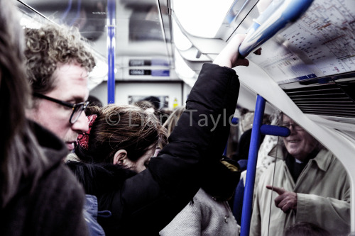 Studying the everyday conformity on the London Underground. Wanna know what that old man's laughing at.