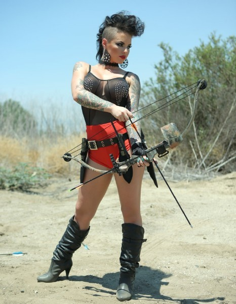 Sidecut? Check. Tattoos? Check. Brunette? Check. Hot badass chick with bow and arrow? CHECK CHECK CHECK