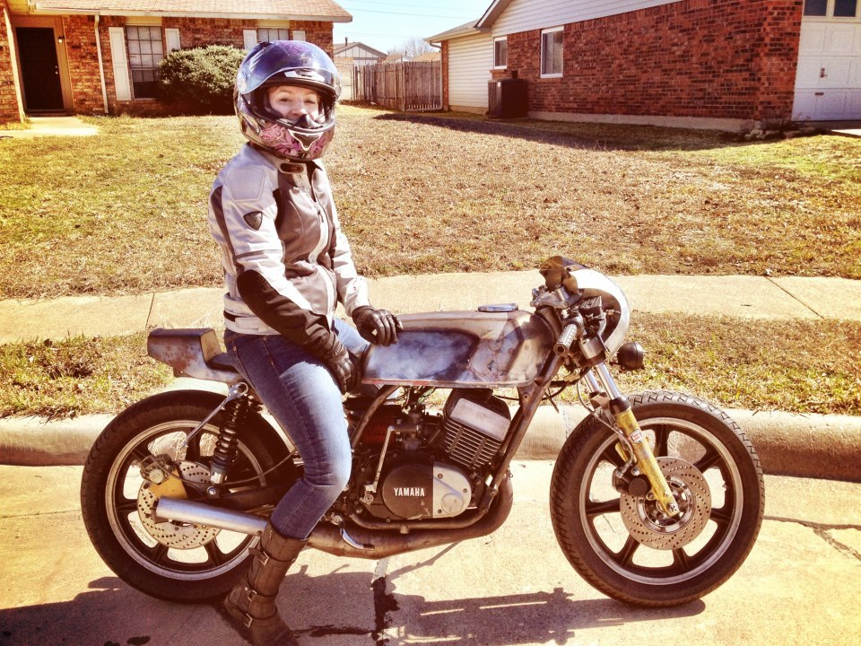 projectuberluger:  motolady:  Happy lady on her cafe racer Yamaha RD.  Before the little RD got his new clothes. (MotoGato tumblr)   check out bf & gf duo http://www.cafematty.com/  You mean husband / wife :)