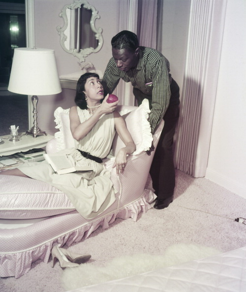 "Nat ""King"" Cole, at home in 1957 with his wife, Maria, contemplates a snack. Photo by: Frank Carroll/NBC/NBCU Photo Bank via Getty Images."