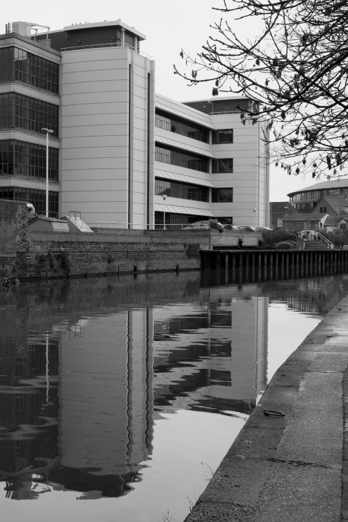 Reflecting on the very abrupt extension to New Castle House. Nottingham, February 2013.