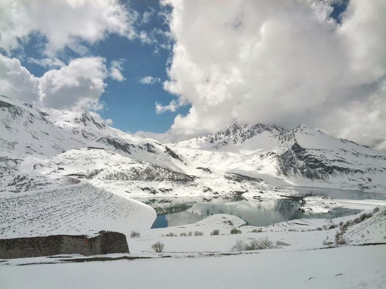 A white paradise at the end of spring.  Lake of Moncenisio, Italy.