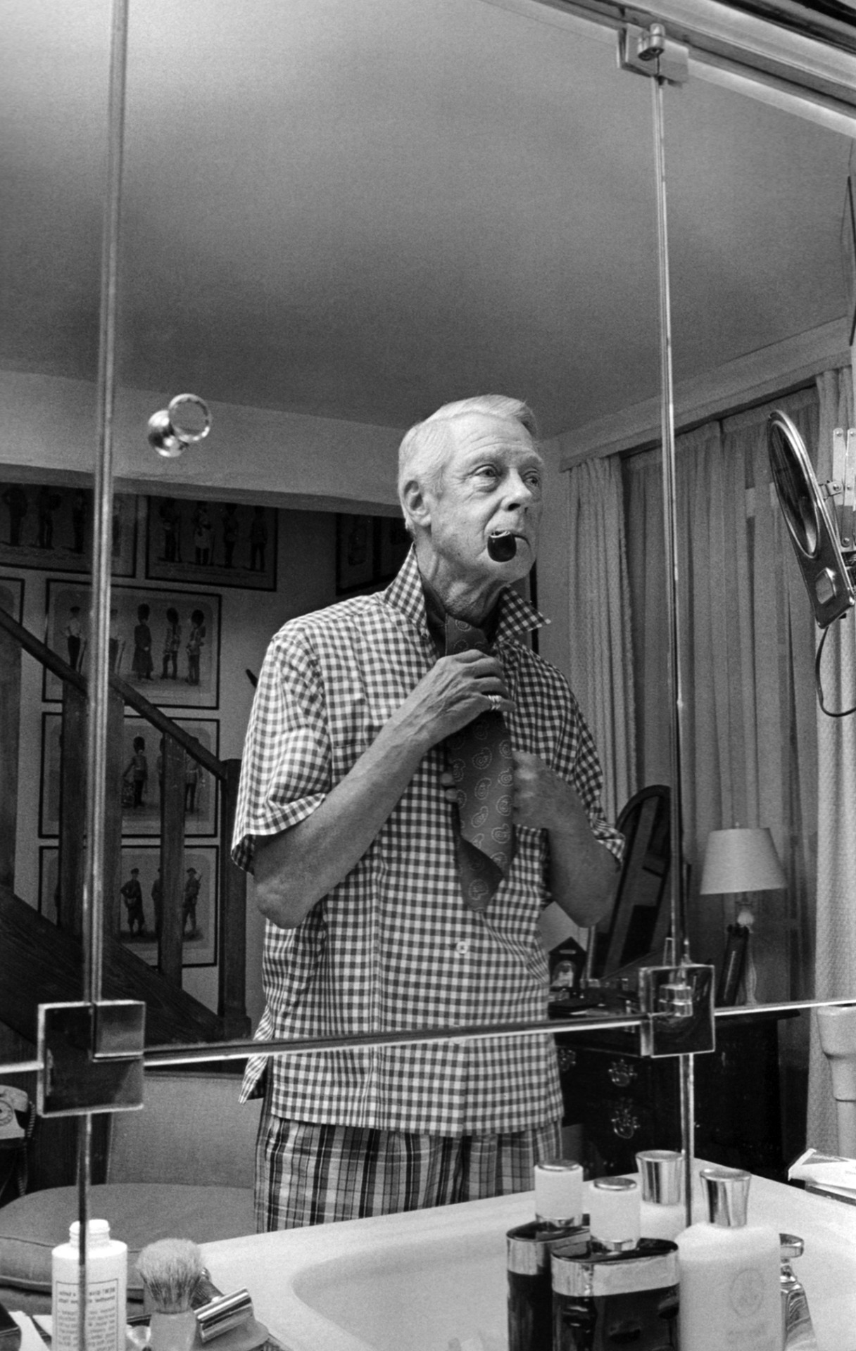 1967. The Duke of Windsor, the pipe, and the covered neck.