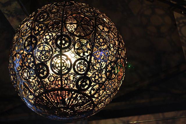 Ballroom Luminoso is a series of six chandeliers designed by artists Joe O'Connell and Blessing Hancock currently installed in San Antonio, Texas. Made from custom made structural steel, custom LEDs and recycled bicycle parts, the lights project colorful silhouettes of sprockets and other pieces onto the otherwise drab cement underpass.