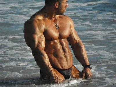 musclelover:  Standing in the sea this hunky muscle guy shows off his abs, pecs and vascular arms. From the delt to the knuckles his veins cover his biceps, triceps and forearms Looking for muscle to worship? Look no further than http://bit.ly/14qL0gL for all your muscle worship desires!