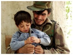 pashtundukhtaree:  An Afghan soldier with his son.