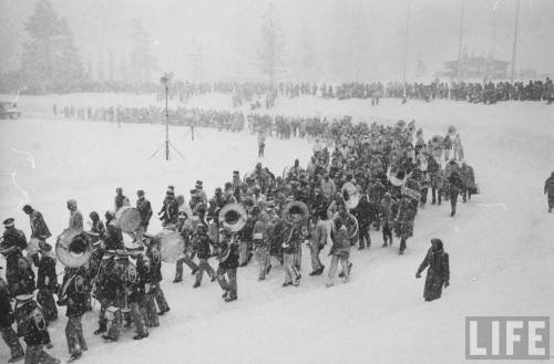 Ralph Crane:  Parade marching in snow during Winter Olympics, Squaw Valley, 1960