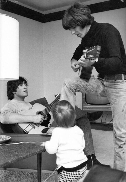 Young Julien Lennon Watches As Dad John And George Play Their Guitars At Home