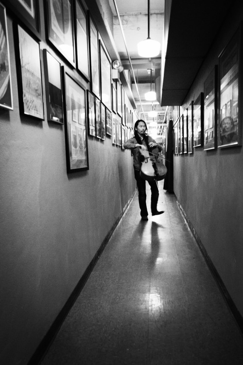 lizdevine:   Joe Kwon practicing in the hallway of the Crystal Ballroom This is an older shot I came across from when The Avett Brothers played a benefit show at the Crystal Ballroom in August of 2010.  Portland, OR    Warming up.