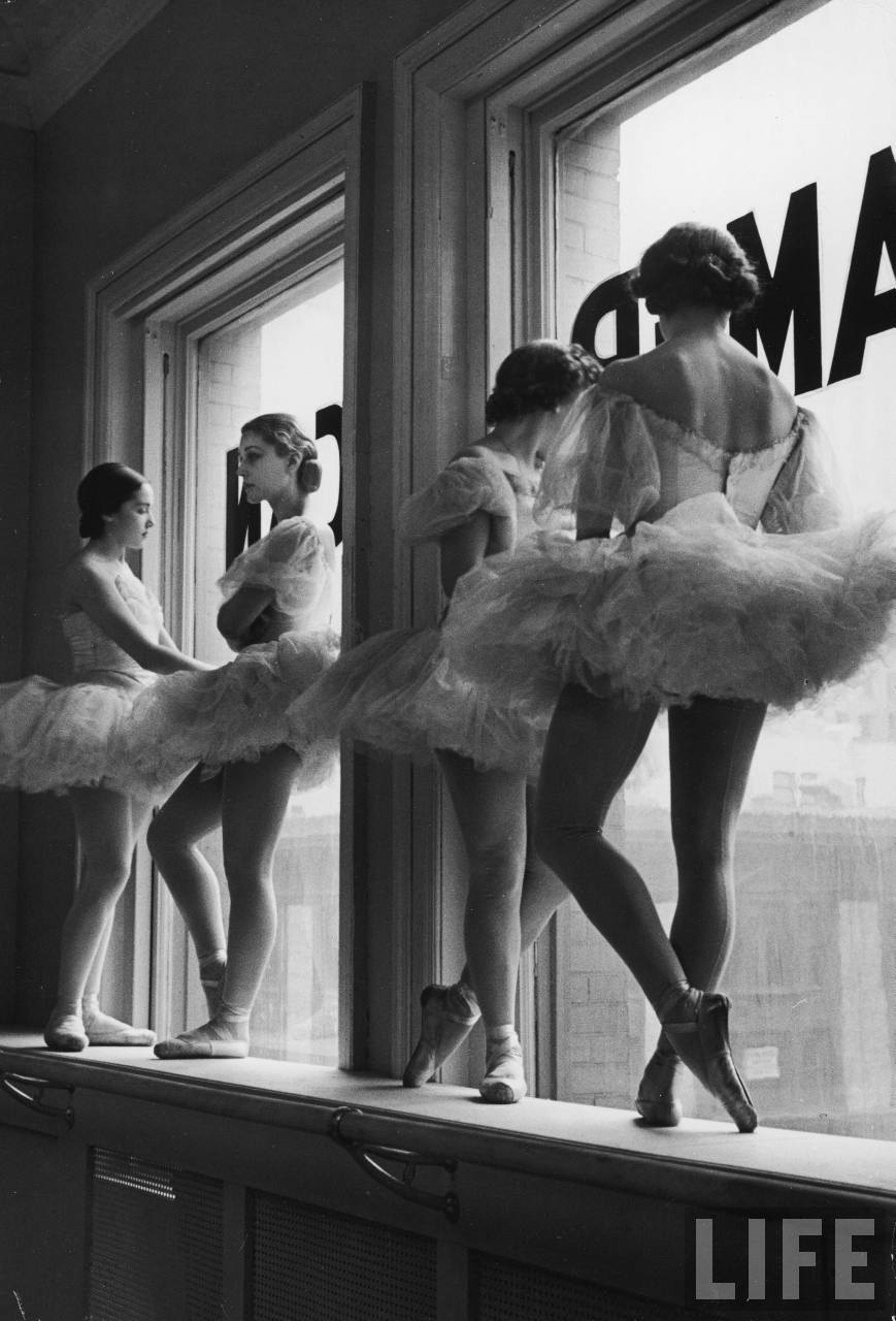 Ballerinas standing on the windowsill at George Balanchine's School of American Ballet. New York, 1936. By Alfred Eisenstaedt