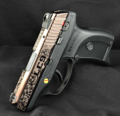 Ruger LC9  from Ruger Custom Shop  - Hand  Engraved. Bronze DLC coated.