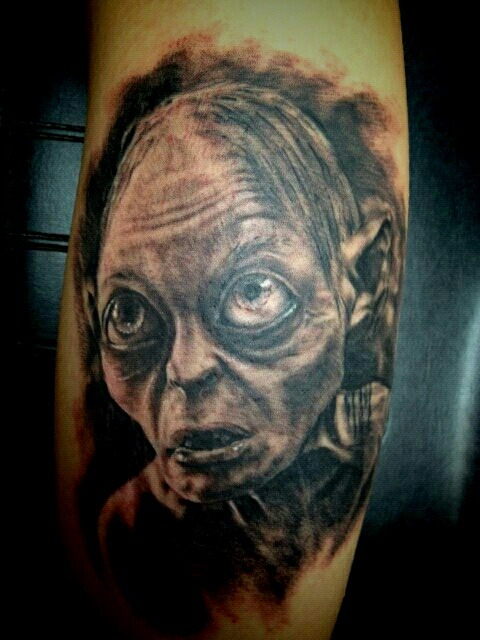 fuckyeahtattoos:  Gollum, done by John at Good Family Tattoo, Lake Villa, Illinois.