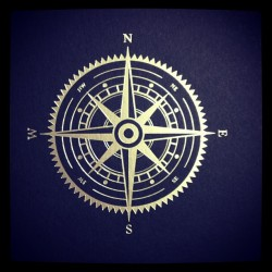 Silver compass in a sea of imperial blue. by glasgowpress http://bit.ly/YhSgvR