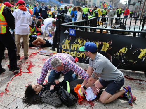 nationalpost:  Authorities identify suspect in Boston Marathon bombing from security video: reportsInvestigators have identified a suspect in the Boston Marathon bombings which killed three and injured more than 150, according to multiple reports.Authorities have a picture of the suspect carrying a black bag near the bomb site, the Boston Globe reports.CNN says a Lord and Taylor department store security camera and a local television station provided footage that helped investigators narrow in on an individual. (AP Photo/The Boston Globe, John Tlumacki)