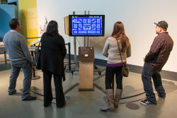 Happy 33rd Birthday to PAC MAN from the Exploratorium! Today, four-person Team Pac-Man is an exhibit we've created here where each person controls one direction: up, down, left, and right—and only through sharing and cooperation can you win! To learn more about our Team Pac-Man exhibit in our new West Gallery (focusing on social behavior) look us up here: http://www.exploratorium.edu/visit/west-gallery/team-pac-man Photo by Gayle Laird © Exploratorium, www.exploratorium.edu