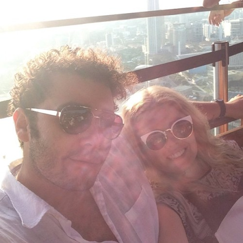 On top of the world at sunset with my love on our last night in Singapore #MarinaBaySandsKuDeTa GET MORE: www.instagram.com/fashionindie