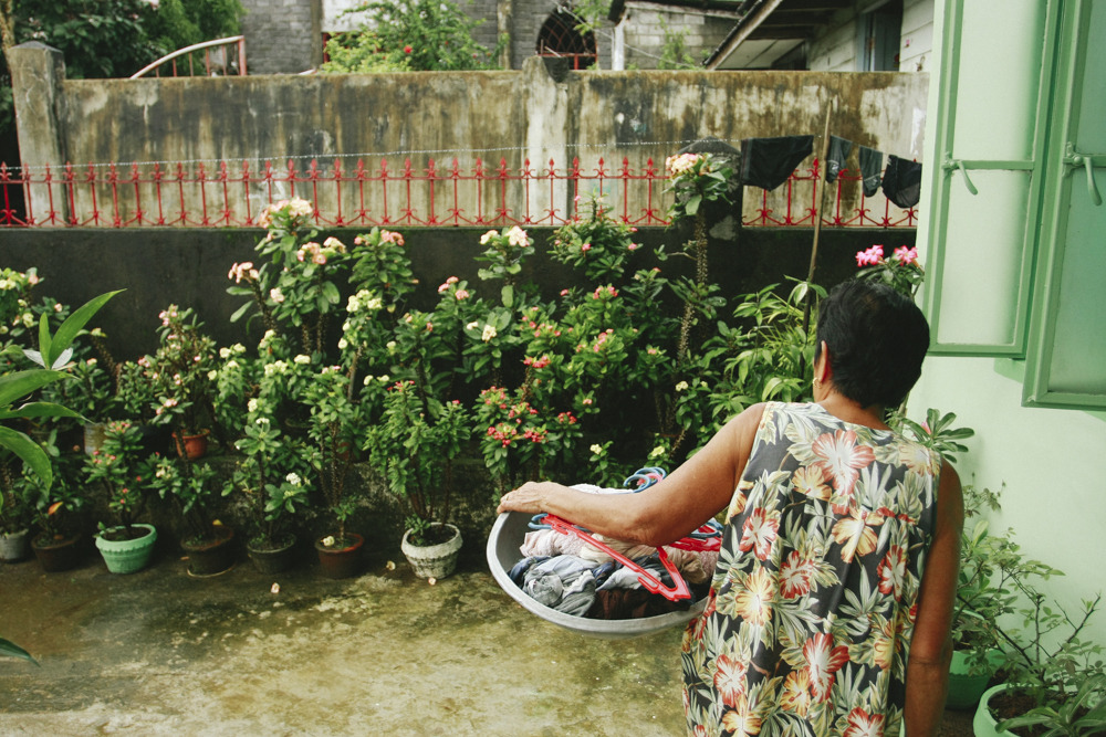 my grandma about the hang clothes at her house in philippines. she almost blends in with all her euphorbia plants, hehe. ©2009