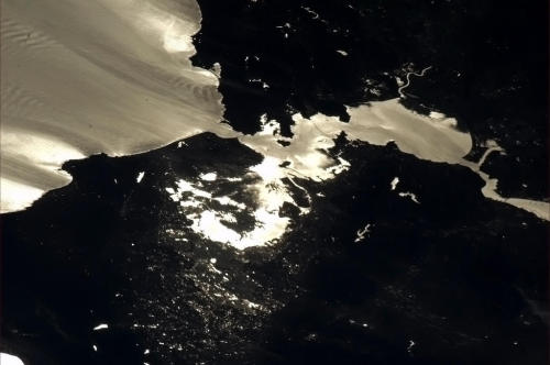 San Francisco Bay Area. The sun glint really shows the water and cloud flow patterns.