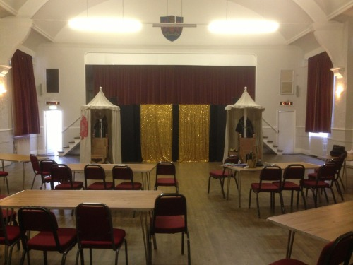 "Appleby Public Hall:  A large hall with a very high stage. Keith (the promotor) was lovely with us, looked after us well and fed us right royally! He even joined us in the pub after the show and bought us a beer! It was great to see Tony Lidington, who managed to make the show and have a quick drink afterwards before he drove back to Devon. It's the first time he's seen the show since the very beginning and the first time he's seen his rewrites. As you can imagine Goodwin an I had some added nerves knowing the writer was in.  Luckily he really enjoyed it and said ""it was very nearly a brilliant show"". High praise indeed I'm sure Tony would still like to rewrite bits, like all of us we want to refine our work.  Unfortunately I managed to scrape the skin off my knuckle during my sword swash buckling and bled heavily through the last few scenes. I had to keep a cloth wrapped round my hand until the final scene. Never good to actually hurt yourself on stage as its quite distracting for the audience. THE GLITZ AND THE GLAM!"