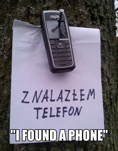 niknak79:  Don't worry, it's a Nokia  I wonder how many nails they broke trying to get that on the tree.
