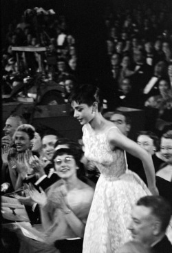 "honornyc:  Audrey Hepburn in 1954, winning her first Oscar for ""Roman Holiday"" and wearing a dress by Edith Head and Givenchy."