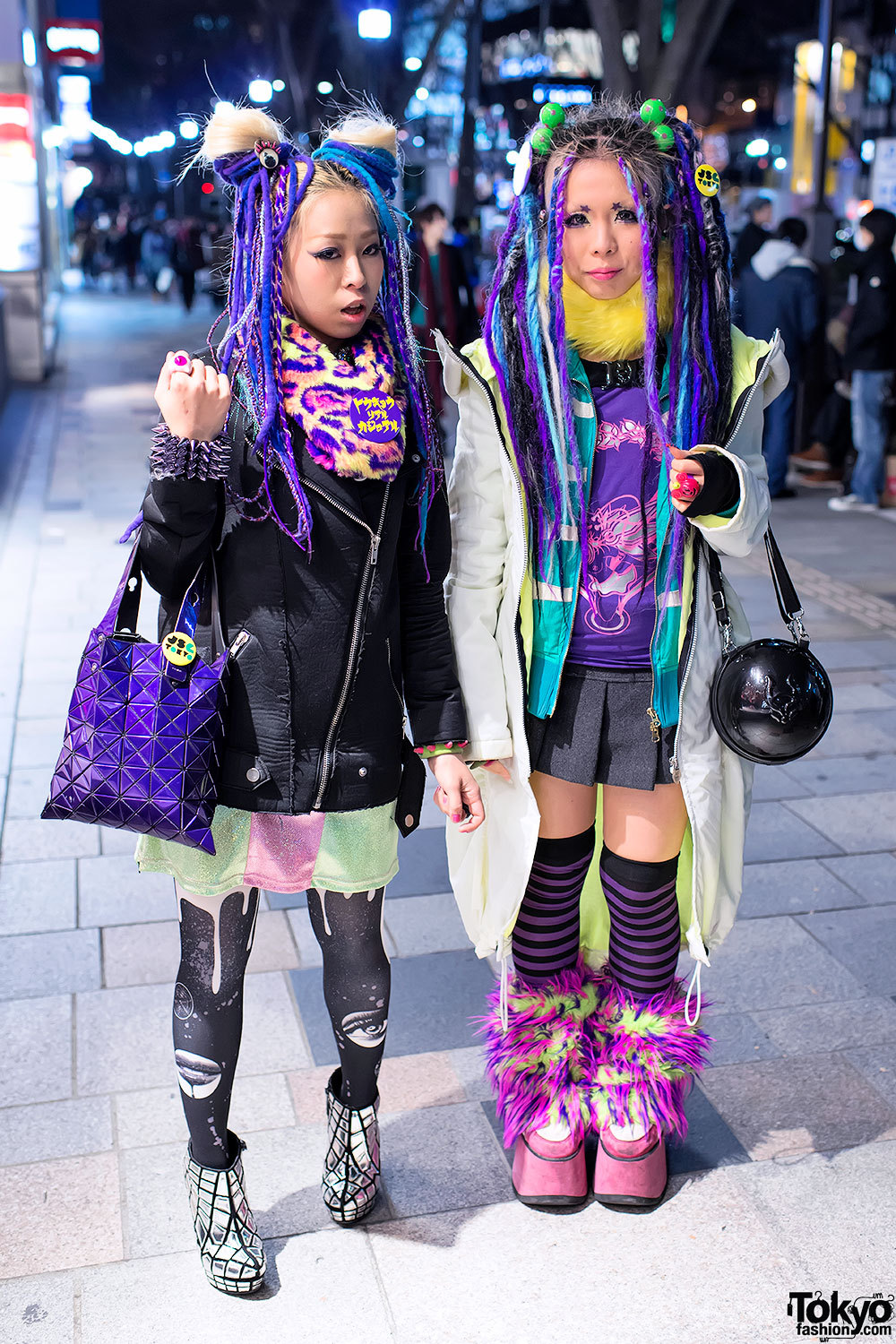 Two awesome Japanese girls - Tokyo Dolores dancer Nancy & Kandi Raver Ichika - rocking purple & blue hair falls on the street in Harajuku.