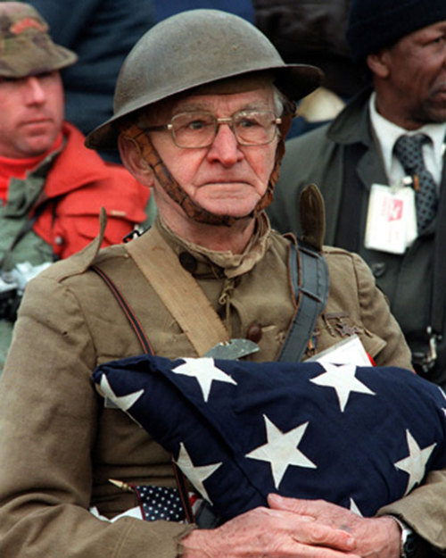 awesome-pictures-awesome:  Joseph Ambrose, an 86-year-old World War I veteran, attends the dedication day parade for the Vietnam Veterans Memorial in 1982, holding the flag that covered the casket of his son, who was killed in the Korean War.  click for ze pics