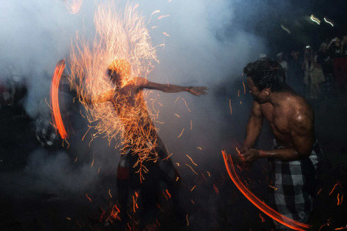 "Reuters  March 11, 2013. Balinese hit each other with fire during the ""Perang Api"" ritual ahead of Nyepi day on the Indonesian island of Bali. Nyepi is a day of silence for self-reflection to celebrate the Balinese Hindu new year, where Hindus in Bali observe meditation and fasting, but are not allowed to work, cook, light lamps or conduct any other activities. Read more: http://lightbox.time.com/2013/03/15/pictures-of-the-week-march-8-march-15/#ixzz2Nlcz18xS"