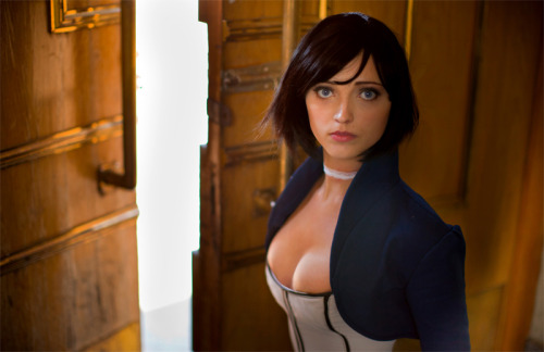 "poinko:  gonegrimdark:  ianbrooks:  Bioshock Infinite: Elizabeth Cosplay by Anna Ormeli I may not be afraid of God, but I'm definitely afraid of how awesome Anna's near-clone-like cosplay of Elizabeth from Bioshock Infinite is, even nailing the same scenes and facial expressions. Really makes you wonder if the creators of the game concocted the character themselves, or if they perhaps had access to a Tear in another dimension and reverse-engineered the appropriately named Anna.  Artist: DeviantArt / Facebook   holy shit she looks just like her????  That's because during the development of Infinite, Irrational liked this cosplayer's version of Elizabeth so much they altered her design to more resemble her, in addition to hiring her to be their Elizabeth for promotional events. ""We love our BIOSHOCK Cosplayers So Much We Hired One!"" at Irrational Games"