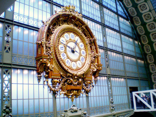 charmainelowe:  A clock at Musee D'Orsay in Paris. This museum used to be a train station, and the clock was kept.