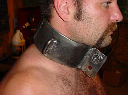 Under the law, owners can choose what type of collar to put on their property.  They can even choose no collar at all.  The owner of this slave has chosen to burden his property with a heavy iron collar.  This slave will NR forget that he is nothing but livestock...Check Out All My Blogs!http://mancunts.tumblr.com/http://wetdreamoblackdom.tumblr.com/http://allaboutmensfeet.tumblr.com/http://dominatehim.tumblr.com/http://blackrulephotoblog.tumblr.com/http://submissivenessisthekey.tumblr.com/http://themalebodyaworkofart.tumblr.com/