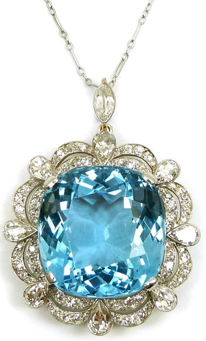 diamondsinthelibrary:  Early 20th century single stone aquamarine and diamond cluster pendant/brooch, c.1920, the cushion shaped aquamarine claw set to a scalloped edge double diamond border, spaced by eight collet set pear shaped diamond accents, mounted in platinum and gold, the brooch fitting and suspension loop both detachable. Via S.J. Philips.
