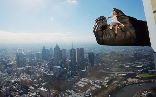 Stuntwoman Leigh-Anne Vizer is held by a 4.5 metre King Kong hand 300 metres above the city of Melbourne during a photoshoot at the Eureka Skydeck, the tallest building in the southern hemisphere, in Melbourne, Australia. The King Kong show is set to open in June in Melbourne. Picture: Scott Barbour/Getty Images