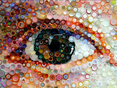 northwesternadmissions:  A close-up of artist Mary Ellen Croteau's eye made from plastic bottle caps and lids of varying sizes. Plastic World, an exhibit by Croteau, opened this month as Northwestern's Dittmar Gallery and runs until May 5. Croteau transforms scraps made from organic polymers into contemporary art in an effort to clean up our environment and draw attention to litter that often goes un-recycled.