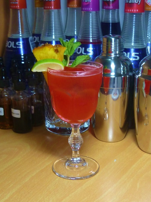 Kon Tiki Ti-Punch Bacardi 8 Rum - 1 2/3 oz Lime Juice - 2/3 oz Grenadine - 1/2 oz Demerara Syrup - 1 tsp Guava Jelly - 1 tsp Pineapple Chunk - 1 Muddle the pineapple chunk and guava jelly with lime juice, add everything else and shake with ice. Strain into a goblet with a large ice cube. Garnish with a lime wedge, a pineapple slice, and a mint sprig. From Merchant Hotel in Belfast, Northern Ireland. Not exactly a place you'd expect a tropical drink, but then again, no tropical drinks were truely invented in the tropics. Most of well-known Tiki drinks out there were created by European or American bartenders to attract customers who wanted a Tiki experience without spending money travelling. I'd highly recommend using homemade guava jelly which you get to choose its sweetness, the drink should be sweet enough on its own without the extra sugar. For the demerara syrup, it's the same as simple syrup but made with demerara/brown sugar. Because the drink was made in the UK, you get measurements like 1/3 or 2/3 oz. 1/3 oz is the equivalent of 10 ml, which is also 2 teaspoons in case your jigger doesn't have this amount on it. 1 2/3 oz is 50 ml.