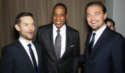 Jay-Z shares a laugh with The Great Gatsby stars Tobey Maguire and Leonardo DiCaprio, at the films premiere in New York on Wednesday night.