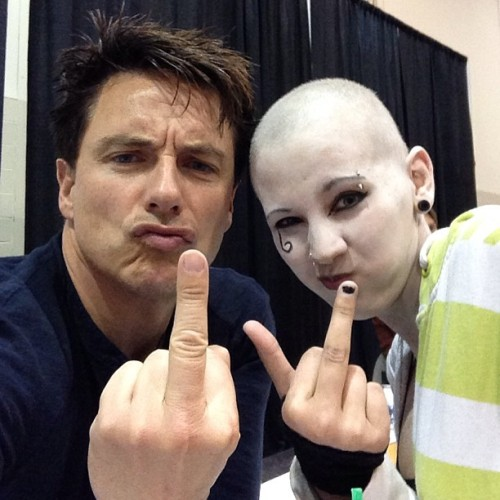 "beautifullydecaying:  So tbis lovely photo, is of Mr. John Barrowman and I. Fucking off cancer.  Today, Jen and I went to get John's autograph (well she did, I just wanted to meet him). Met a totally awesome guy named Logan in the lineup. Squeed.   When we finally got to John, he signed Jen's converse and I told him how my friend Wanda met him at the hub last night, and how i had beaten cancer last week. He then told me congratulations, and went on to talk about his one friend's mom just beat cancer and asked to take a picture with me.   He posted it on Instagram, and Twitter. He then gave me a hug, told everyone in the line I'm an exception for beating cancer. He told me he was proud of me.   Basically when everyone started clapping I started crying.    Oh, and Jen, Shelbey and I were the ones to yell that ""We love you more than Dean does"" during Misha's panel."