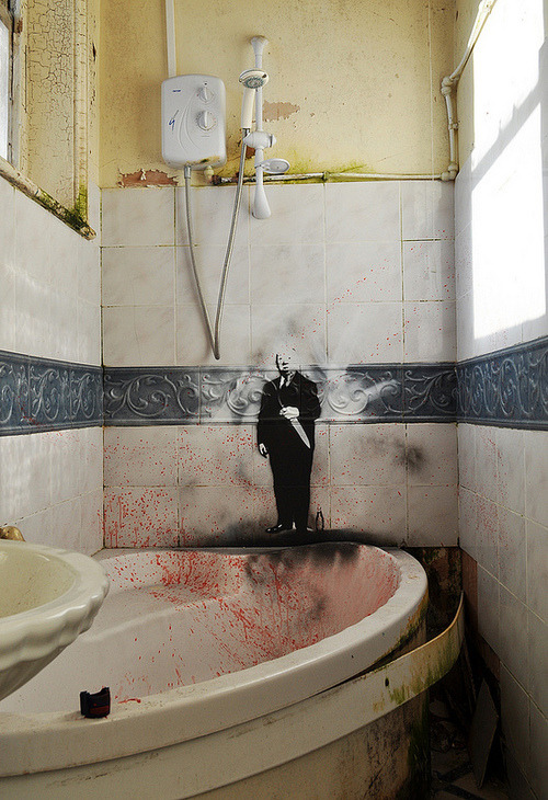 Hitchcock's Psycho Bathroom Art by Id-Iom and Agent Provocateur Before their studio building got demolished, it needed the proper adornment for its own funeral. Several walls were repainted with soon-to-be annilated arts, including this Hitchcock stencil which watched you as you bathed. The blood splatter is purely coincidental. See all the pictures of the house's final day over at the flickr.  Agent Provocateur: Website / Id-Iom: Website